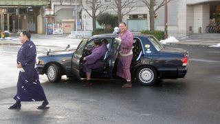 Sumo wrestlers in cars